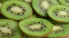 Kiwi fruit slices, closeup Stock Footage