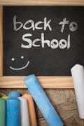 Slate with colorful crayon, back to school Stock Photos