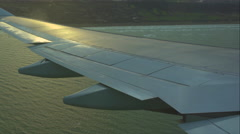 Airplane wing above the sea (GRADED) - stock footage