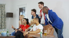 4K Friends watching sports game on TV have negative reaction to action on screen - stock footage