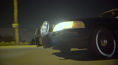 Police car night drive exterior through suburbs - wide (GRADED) - stock footage