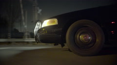 Police car driving through suburbs at night (front side) (GRADED) - stock footage