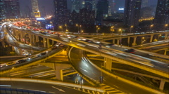 Night time lapse traffic driving across major elevated highway Shanghai, China Stock Footage