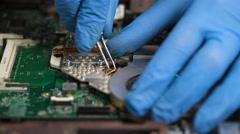 Man repair laptop motherboard with screwdriver Stock Footage