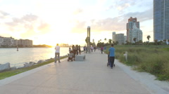 People enjoying the sunset at South Pointe Park - stock footage