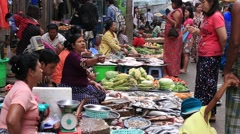 People buy and sell seafood and products on the street food market, Myanmar Stock Footage