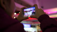 Spectator hands holding shooting video via smartphone of a concert performance Stock Footage
