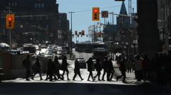 Pedestrians cross intersection on Rideau Street in Ottawa, Canada. Stock Footage