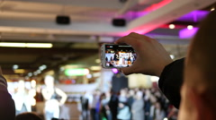 Spectators hands holding shooting video via smartphone of a concert performance Stock Footage