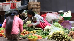 People buy and sell vegetables and fruit on the street food market, Myanmar Stock Footage