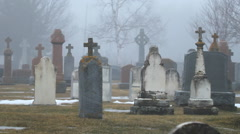Misty graveyard with old gravestones. Near Perth, Ontario, Canada. Stock Footage