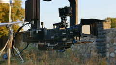 The operator set up the camera before film shot. Real time capture Stock Footage
