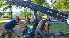 The shoot a scene with a crane on a rail. Real time capture - stock footage
