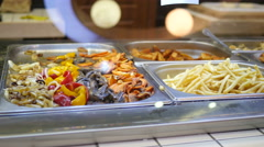 Showcase of food court market in a mall - salad vegetables, french fries, meat Stock Footage