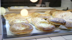 Showcase of a food court market in a city mall - bakery products Stock Footage