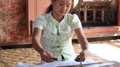 Making the thread of a lotus. Burmese woman made yarn. Myanmar, Burma Stock Footage