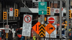 Lots of signs with buses and people. Rideau Street, Ottawa, Canada. Stock Footage