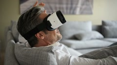 Closeup of man using virtual reality headset, VR mask Stock Footage