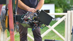 The operator set up the camera before film shot. Real time capture - stock footage
