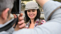 Man taking picture of girlfriend, week-end travel Stock Footage