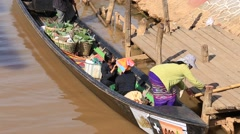 Local people transporting good on wooden boat on Inle Lake, Myanmar. Burma Stock Footage