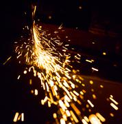Sparks in the dark - stock photo