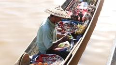 Burmese man on small long wooden boat selling souvenirs. Inle lake, Myanmar Stock Footage