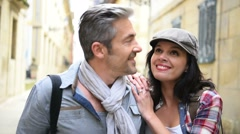 Couple of tourists walking in historical quarter of Spain Stock Footage