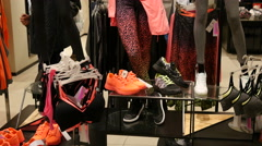 Mannequins and shelves with fashionable clothes in a store boutique - shopping Stock Footage