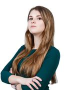 Young woman with crossed hands - stock photo