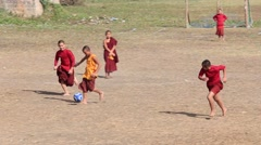 Group of young monk playing soccer. Myanmar, Burma Stock Footage
