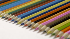 Stock Video Footage of Lin of colour pencils isolated on white background close up