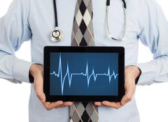Doctor holding tablet - Heartbeat graph Stock Photos