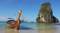 Long tail boat on tropical beach, Thailand - stock footage
