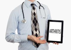 Stock Photo of Doctor holding tablet - Arthritis
