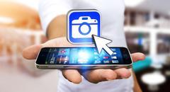 Young man using modern camera application Stock Photos