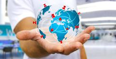 Businessman holding digital world map in his hands Stock Photos