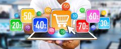 Young man shopping during sales period - stock photo