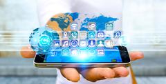 Businessman using modern digital applications Stock Photos
