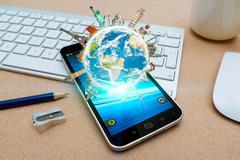 Modern mobile phone with digital world landmarks Stock Photos