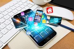 Modern mobile phone connecting tech devices Stock Photos