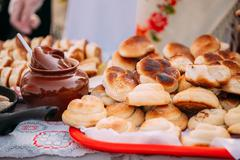Dishes of the traditional Belarusian cuisine - fresh pastries an - stock photo