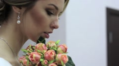 beautiful bouquet of different colors in the hands of the bride in a white dress - stock footage