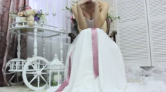 beautiful bride sitting on a chair. bottom view - stock footage