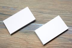 Business card blank over office table. Corporate stationery branding mock-up - stock photo