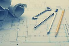 Architect worplace top view. Architectural project, blueprints, blueprint rolls Stock Photos
