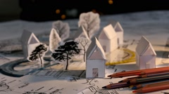 Stock Video Footage of blueprint - map - tree - houses - cutouts - crayons 01
