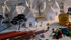 Stock Video Footage of blueprint - map - tree - houses - cutouts - crayons 03