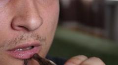Closeup man mouth breathing out a smoke - smoking electronic cigarette Stock Footage