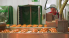 Baking production line in action and unrecognizable blurred worker Stock Footage